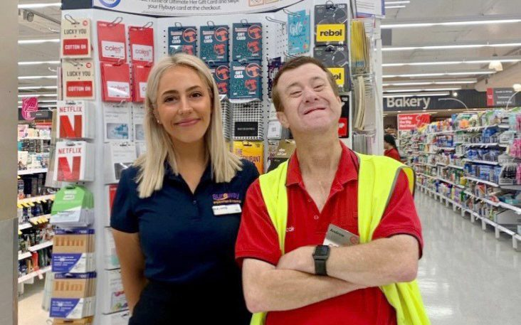 Coles employee and Sureway ESO Mia at Andrew's workplace